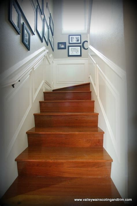 Raised panel wainscoting going up stairs