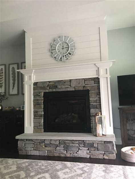 Fireplace mantel stacked stone hearth ship lap white
